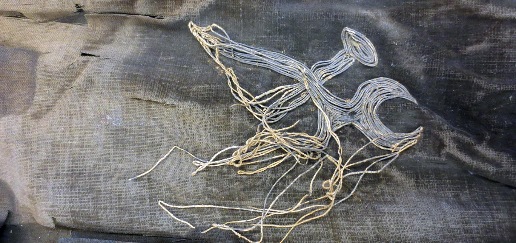 Repairing the kimono oni figure (1964.1.2.5)