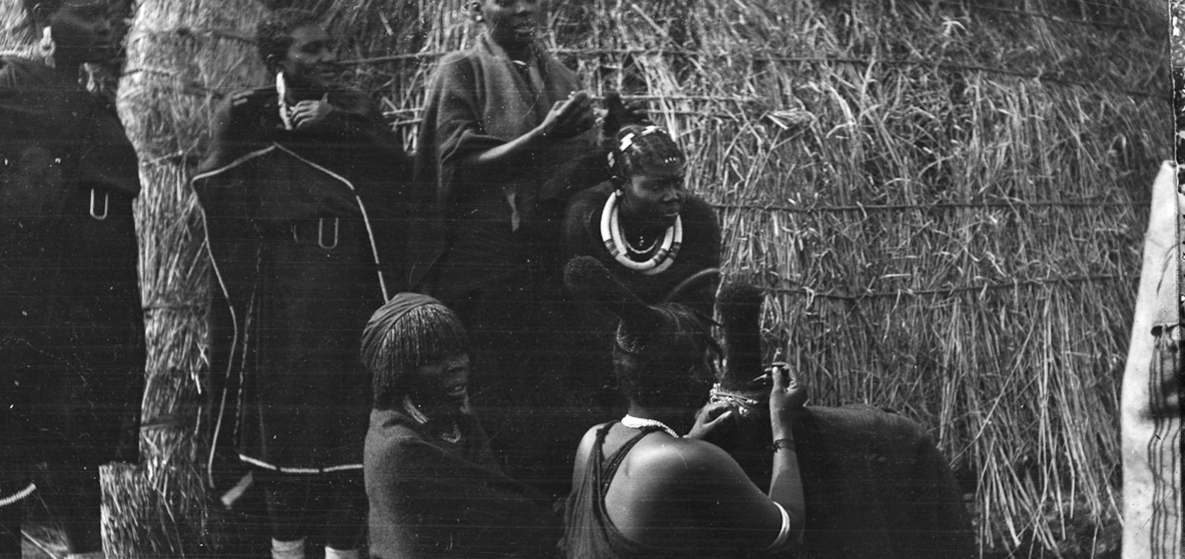 Group of Zulu women dressing each other's hair. Photo taken by Henry Balfour near Pietermaritzburg, South Africa, 1905 [1999.11.27].