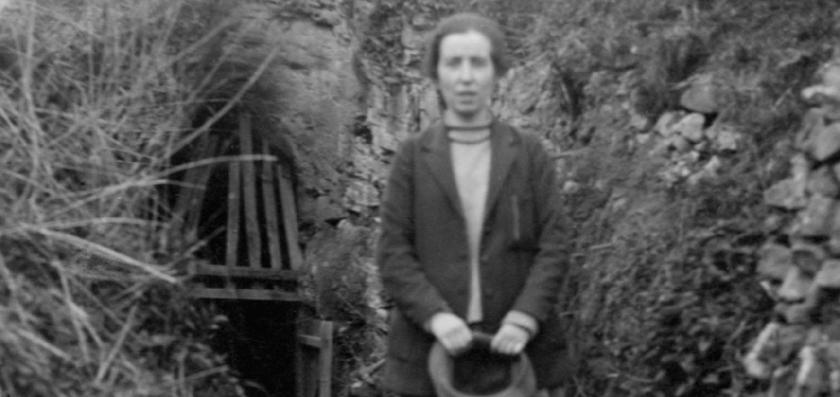 Portrait of Dorothy Garrod outside a British cave sometime in the 1920s (possibly Langwith Cave, Derbyshire, where she excavated briefly in 1927). (Copyright Pitt Rivers Museum, University of Oxford. Accession Number: 1998.294.688)