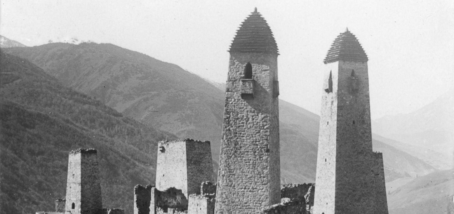 Look-out and refuge towers in Arzee. Similar towers were built all over the eastern Caucasus, though few remain today. Photograph by John Baddeley. Arzee, Russia. October 1901.