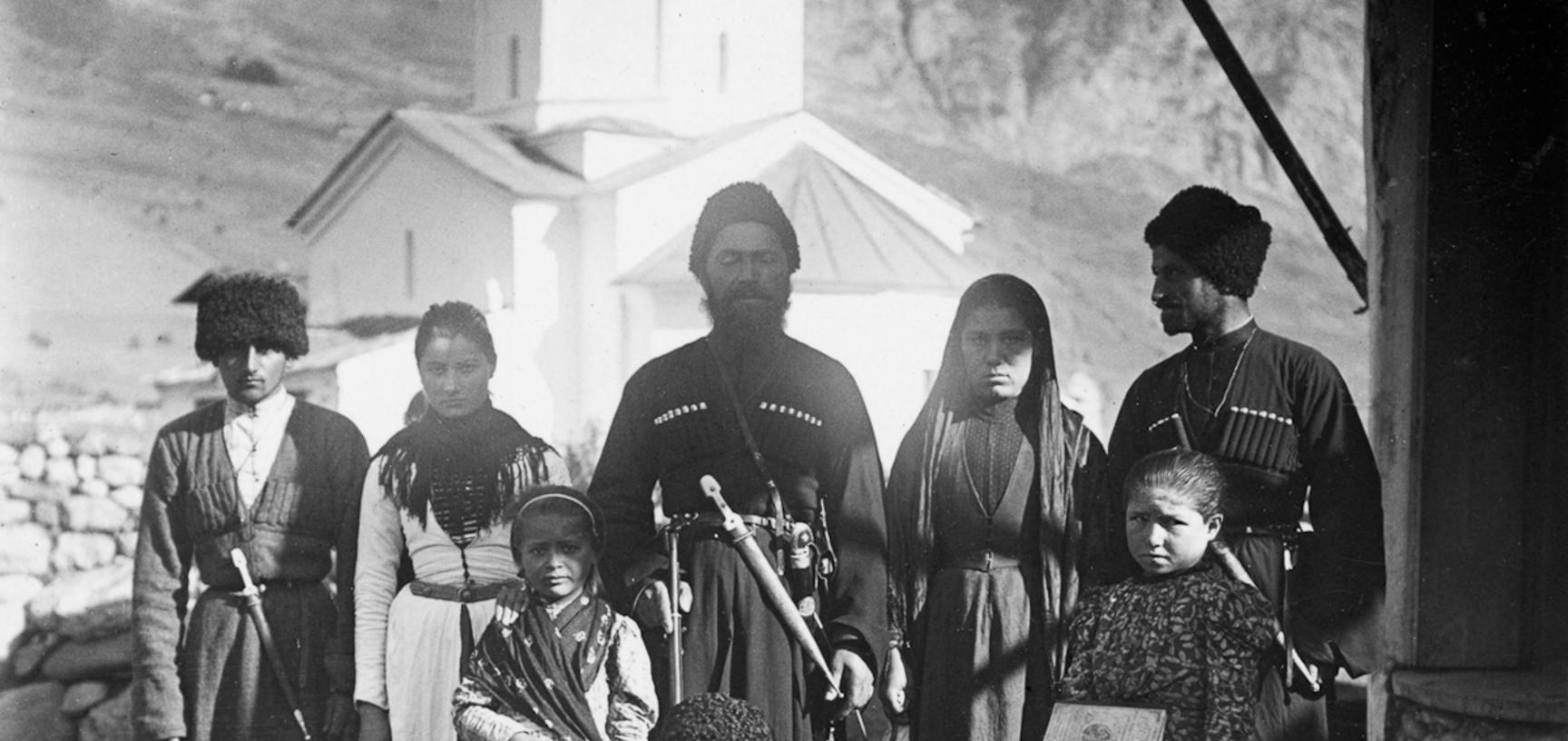 People in front of the church at Dallagkau near Kazbek. Photograph by Baddeley. Dallagkau, Republic of North Ossetia-Alania, Russia. August 1902.