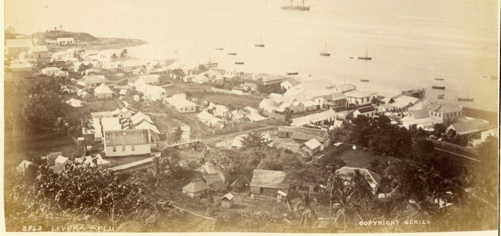 View of the former capital of Levuka on the Fijian island of Ovalau, 'taken from the hills above the Hospital'. Photograph by Alfred Burton for the Burton Brothers studio (Dunedin). Levuka, Ovalau, Fiji. 14 July 1884.