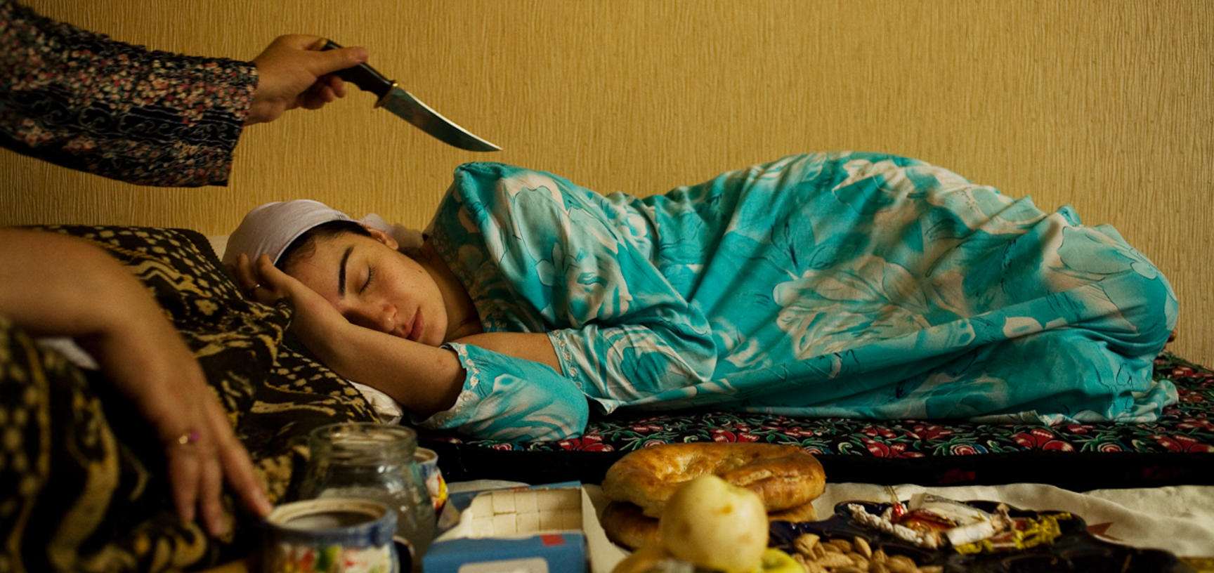 A healer works to cure tiredness due to a recent bereavement. Dushanbe, Tajikistan. Photograph by Carolyn Drake. July 2008.