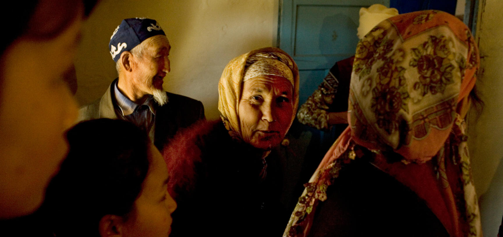 Guests enter a village home during the annual Navrus festival. Shege, Uzbekistan. Photograph by Carolyn Drake. March 2008.