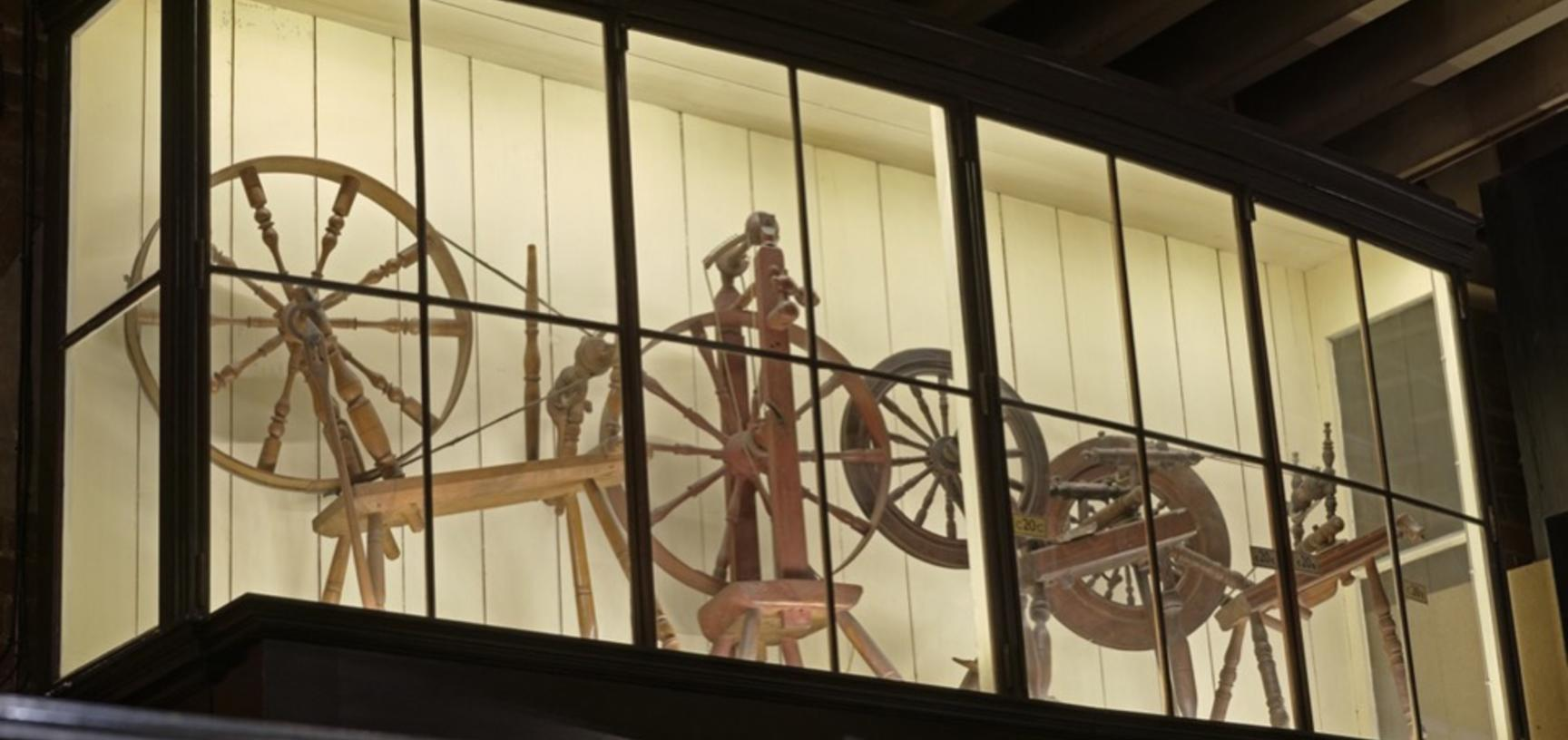 Before and after. Perhaps you never previously noticed this display of spinning wheels high up in the Court (ground floor)? New LED lighting, plus the conservation, re-positioning and titling of case contents, has brought these displays back to life.