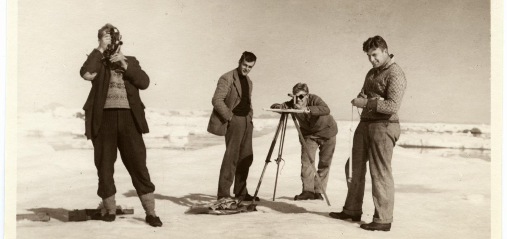Group portait of expedition members L. R. Wagner, Augustine Courtauld, Alfred Stephenson and Wilfred Hampton posing with surveying equipment. Photograph by Henry Iliffe Cozens. Greenland. 1930–1931.