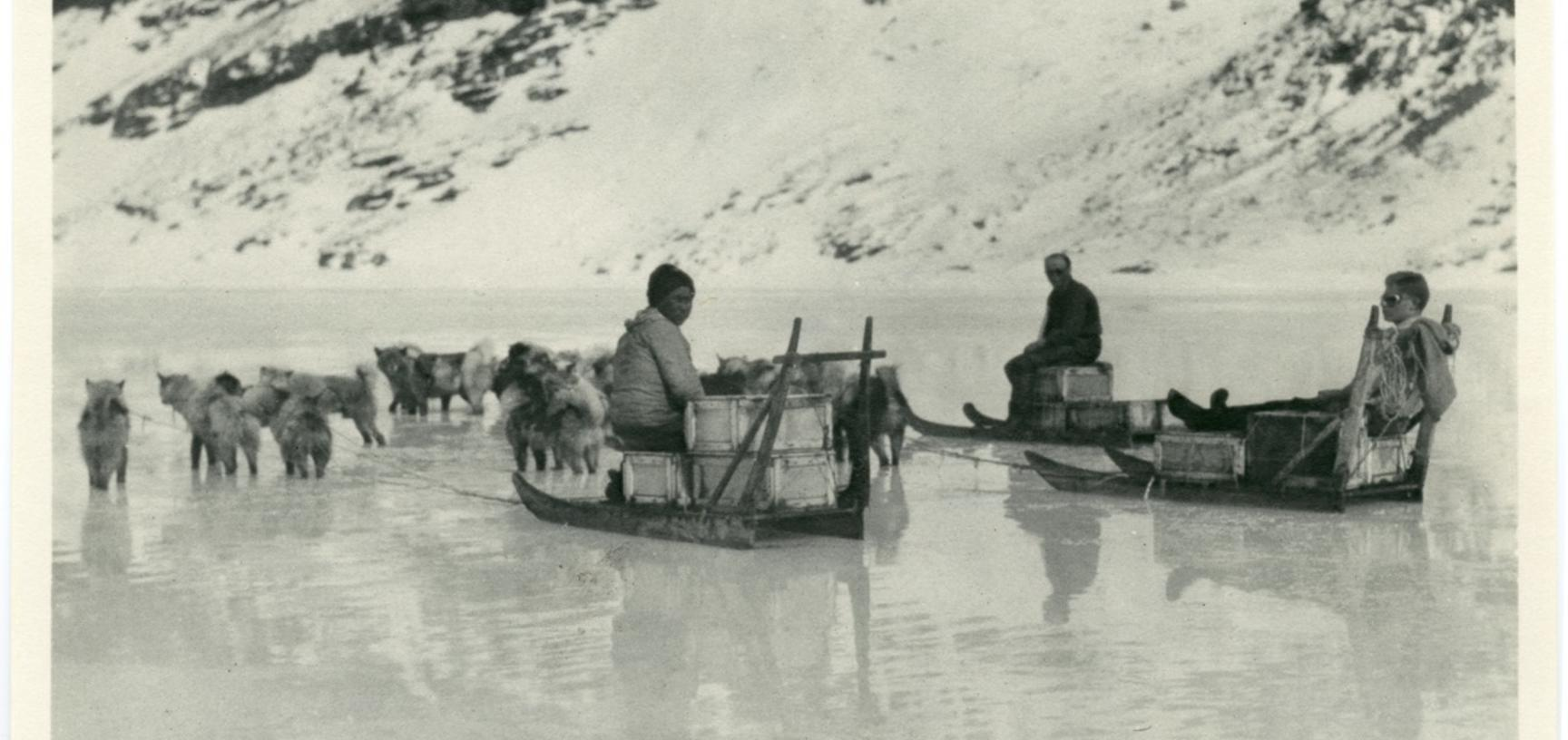 Rebecca (Inuk), Percy Lemon and Alfred Stephenson seated on sledges at Base Fjord. Photograph by Henry Iliffe Cozens. Base Fjord, Greenland. 1930–1931.