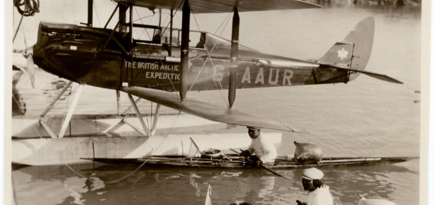 A small De Havilland Moth biplane used in the expedition, shown here with landing gear of water floats. Photograph by Alfred Stephenson. Greenland. 1930–1931.