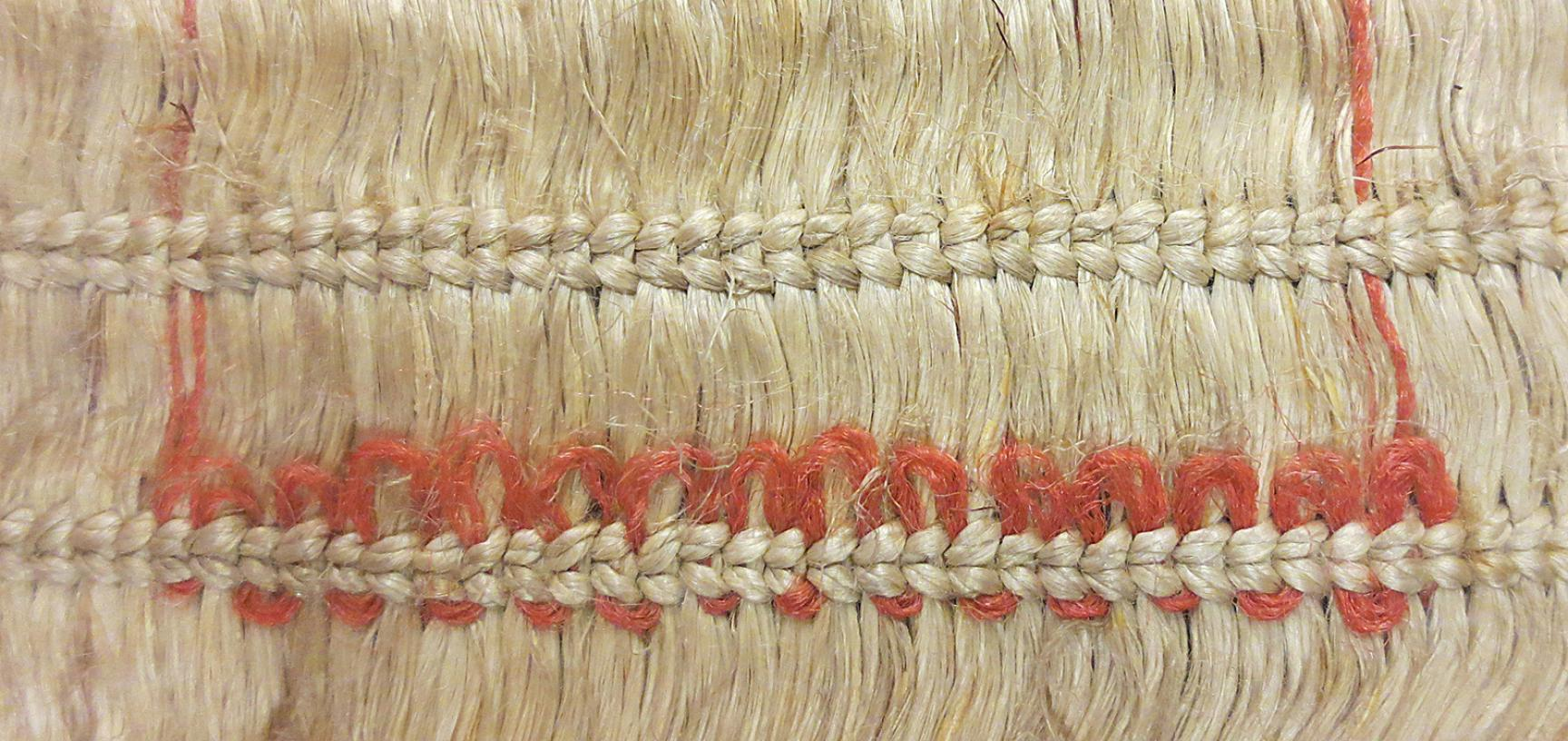 Detail of European wool decoration on cloak (1886.1.1132)