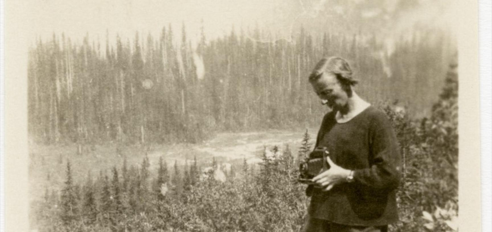 Beatrice Blackwood taking a photograph during her fieldwork in Yoho Valley, British Columbia, Canada, in 1925. Photographer unknown; print donated by Beatrice Mary Blackwood to the Pitt Rivers Museum in 1973. (Copyright Pitt Rivers Museum, University of O
