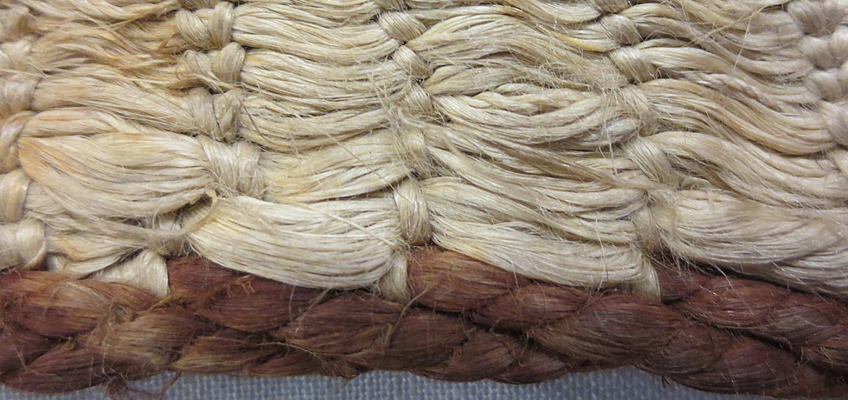Detail of side border showing muka (flax fibre) in cloak (1886.1.1132)