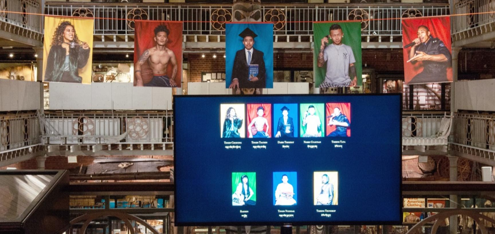 One of two digital display screens on the Lower Gallery's Clore Learning Balcony, part of the exhibition 'Performing Tibetan Identities: Photographic Portraits by Nyema Droma', Pitt Rivers Museum, University of Oxford, 13 October 2018 to 30 May 2019.