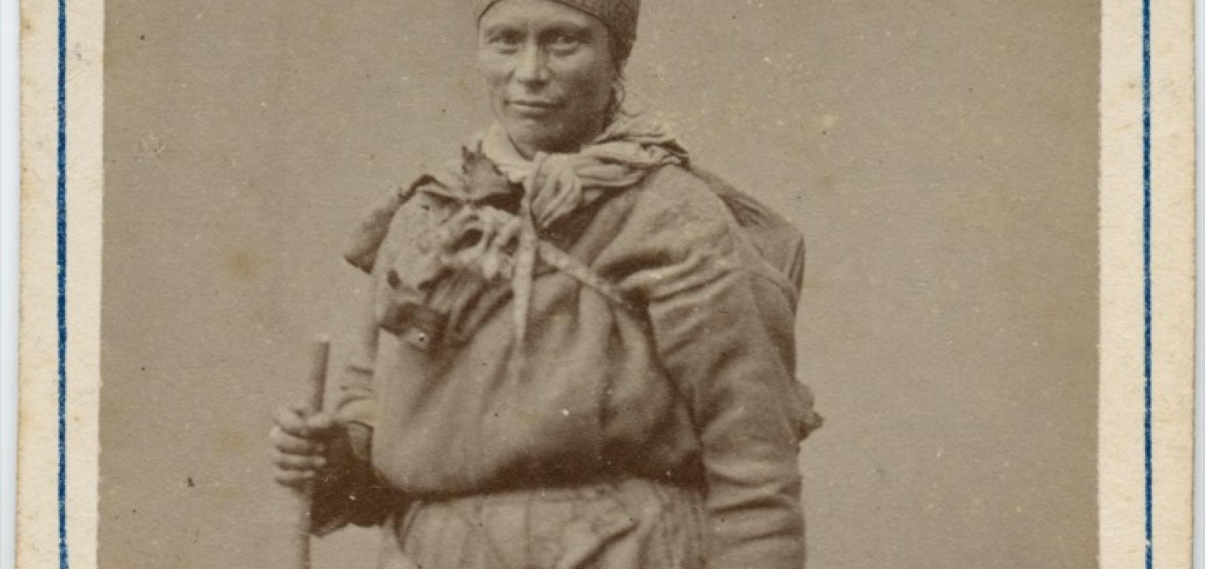 Studio portrait of a Saami woman, standing, holding a bag. Photograph by the Jørgen Wickstrøm studio. Tromsø, Norway. Circa 1870s. (Copyright Pitt Rivers Museum, University of Oxford. Accession Number: 1941.8.47)