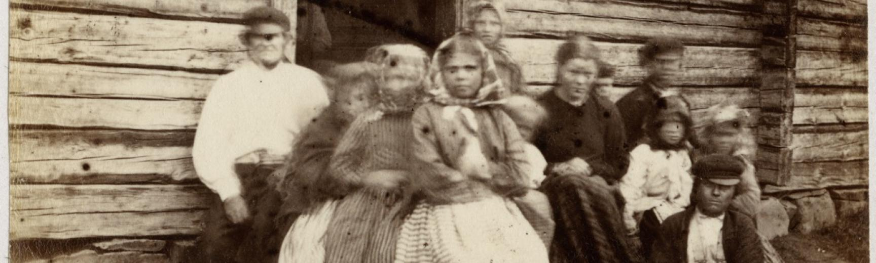 Portrait of a Finnish family. In his diary Evans described photographing such a group: 'At Rungam, where we once more crossed the river Kemi, I tried taking a photograph of a large group of Finns, & actually succeeded in getting them to sit, but when the