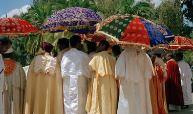 Bishops of the Ethiopian Orthodox Church outside Trinity Cathedral, where the Emperor's remains were later buried. Addis Ababa, Ethiopia. Photograph by Peter Marlow. 2000.