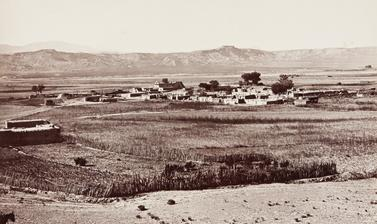 San Ildefonso Pueblo, possibly established as early as 1300, with its church (constructed under the direction of the Franciscans in 1717) clearly visible in the distance.