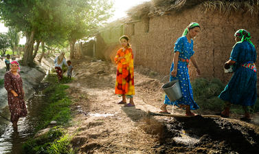 The intermittent flow of an irrigation canal is the only source of water in a village in south-western Tajikistan built for cotton farming under the Soviet Union. Yulduzqoq, Tajikistan. Photograph by Carolyn Drake. July 2008.