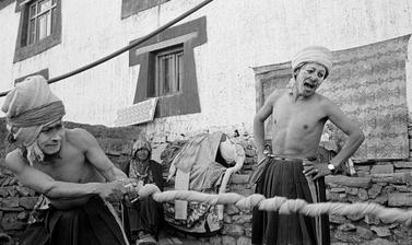Buchen dressed as beggars undertake a tug of war, during a performance of 'The Elephant', a scene from the story of Prince Drimed Kunden. Photograph by Patrick Sutherland. Lara, Spiti, Himachal Pradesh, India. 2004.