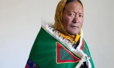 Gatuk Namgyal dressed as a poor woman. Photograph by Patrick Sutherland. Sangnam, Spiti, Himachal Pradesh, India. 2010.