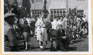 'The Morrisdancers at Bampton, Oxon, 1949. The accordeon player is old Mr. Kimble' (typed caption). Photograph by Ellen Ettlinger. Bampton, Oxfordshire, England. 1949.