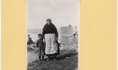 'Woman with her grandson. Note skirt on boy and the broad celtic type of head of woman' (typed caption). Photograph by Thomas H. Mason. Aran Islands, County Galway, Ireland. Undated.