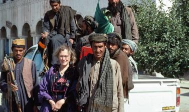 Sheila Paine with a group of mujahideen in northern Afghanistan. Around her neck she is wearing a triangular embroidered amulet, central motif of her book The Afghan Amulet. (Copyright Pitt Rivers Museum, University of Oxford. Accession Number: 2016.4.57)