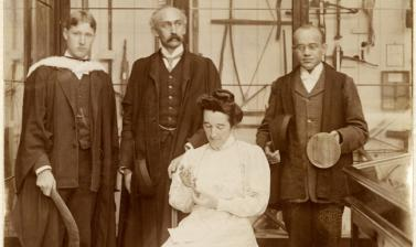 Group portrait of the first three students on the University of Oxford's Diploma in Anthropology, with Henry Balfour, Curator of the Pitt Rivers Museum. Taken in 1908 on the Museum's Upper Gallery, the students are examining objects from the Museum's coll