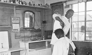Barber shop. Langa, Cape Town, South Africa. Photograph by Bryan Heseltine. Circa 1949–1952. (Copyright Bryan Heseltine)
