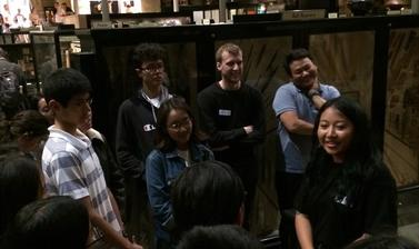 Nyema Droma discussing her work with teenage members of the UK's Tibetan community during a public engagement event, 'My Tibet Museum', held at the Pitt Rivers Museum in October 2018. (Copyright Pitt Rivers Museum, University of Oxford)