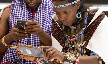 Maasai group looking at artefacts