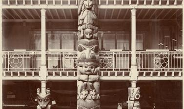 Interior view of the Pitt Rivers Museum, looking towards the east end of the Court, showing the Haida totem pole.
