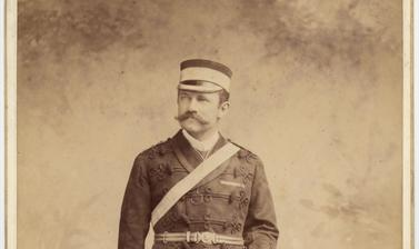 Cabinet card portrait of Colonel Robert Gosset Woodthorpe, standing, dressed in military uniform of the Corps of the Royal Engineers. Photograph by the P. A. Johnston and Theodore Julius Hoffmann studio (Calcutta), labelled 'Johnston [and] Hoffmann'. Calc