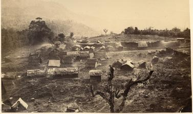 View of an unidentified Naga settlement on a hillside. Photographer unknown. Naga Hills District of Assam (now in Nagaland), India. 1873–1874.
