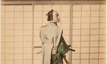 Portrait of a man dressed as a samurai and carrying a daishō or pair of long and short swords (katana and wakizashi). Photograph by the Adolfo Farsari studio ('A. Farsari & Co.'). Yokohama, Japan. Circa late 1880s. (Copyright Pitt Rivers Museum, Universit