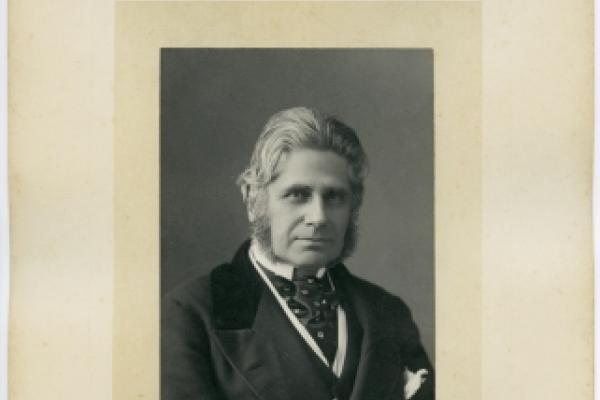 framed portrait photo of a smartly dressed older man