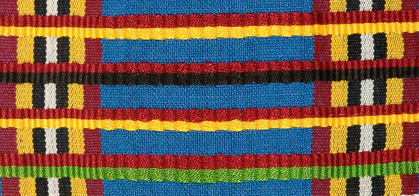Brightly coloured chequered woven textile, using red, yellow, black, white and green stripes.  These cloths are woven in narrow strips which are then stitched together.