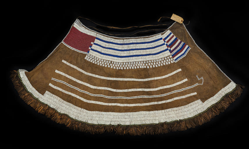 Beaded hide skirt with hide tassels. The skirt was made prior to 1940 and would have been worn during the Marmo ritual initiating young Iraqw girls into womanhood.